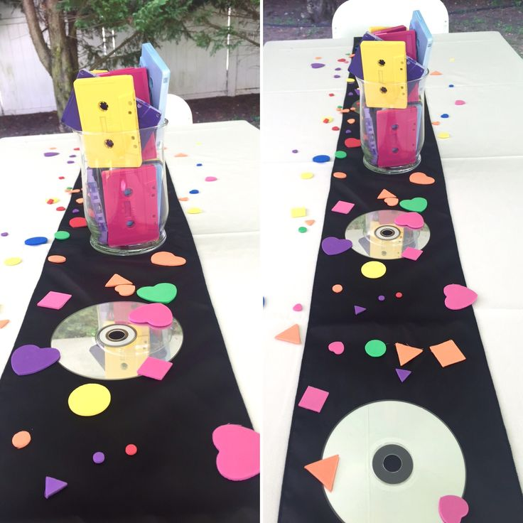 90's theme party centerpiece. Found some old CD's in the basement (which we all know we won't use anymore), placed them upside down on both sides of the vase along the table runner. Make sure to clean the CD's for scratches like you did in the old days when you wanted to listen to your favorite tunes. Makes them look nice and shiny on the tables.