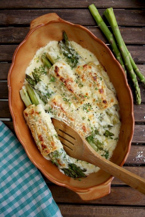 Baked Asparagus Cannelloni: Impressive but easy-to-make spring entreé. Mild asparagus wrapped in salty prosciutto and lasagna sheets with creamy and silky béchamel sauce and crispy Parmesan crust. Guilty pleasure for the special occasion!