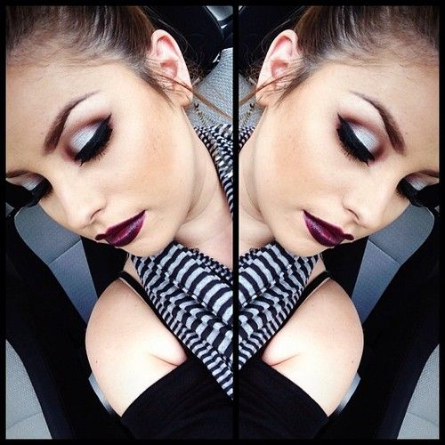 Beautiful silver/plum-brown eye makeup and love the deep cranberry colored lips.
