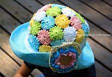"""Панамка крючком - всегда интересна и оригинальна. Сегодня мы предлагаем вам связать вариант, который придумала мастерица Джоан, автор блога """"Craft passion"""".  Эта панамка крючком девочке связана из цветочных мотивов и снабжена широкими полями, которые надёжно защищают от яркого солнца.  Цветочные мотивы крючком сделаны из разноцветной пряжи. Это не простые цветочные мотивы, а так называемые йо-йо крючком, круглые двойные мотивы, связанные столбиками с 4-мя накидами. Вязать их легко, ..."""