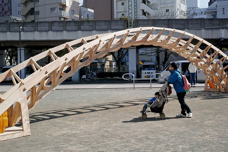 vuild studio's structure uses traditional japanese joining techniques by ways of wooden driving plugs, in order to create their temporary, transportable bridge.