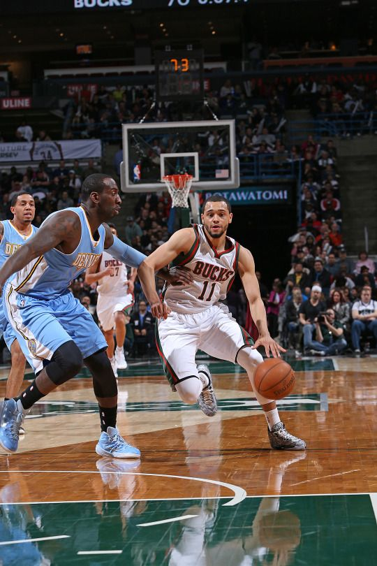 Tyler Ennis #11 of the Milwaukee Bucks handles the ball against the Denver Nuggets during the game on February 20, 2015 at the BMO Harris Bradley Center in Milwaukee, Wisconsin. (Photo by Gary Dineen/NBAE via Getty Images)