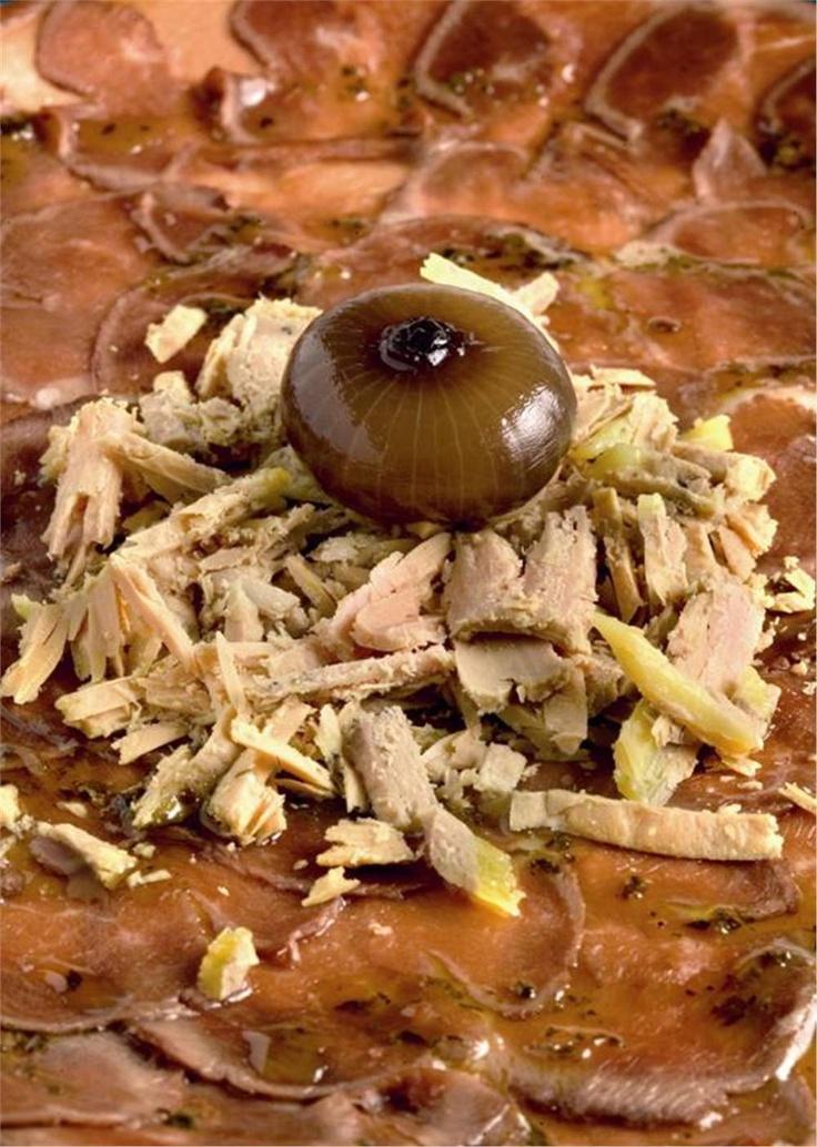 Carpaccio de magret de pato con virutas de foie gras. Refinado.