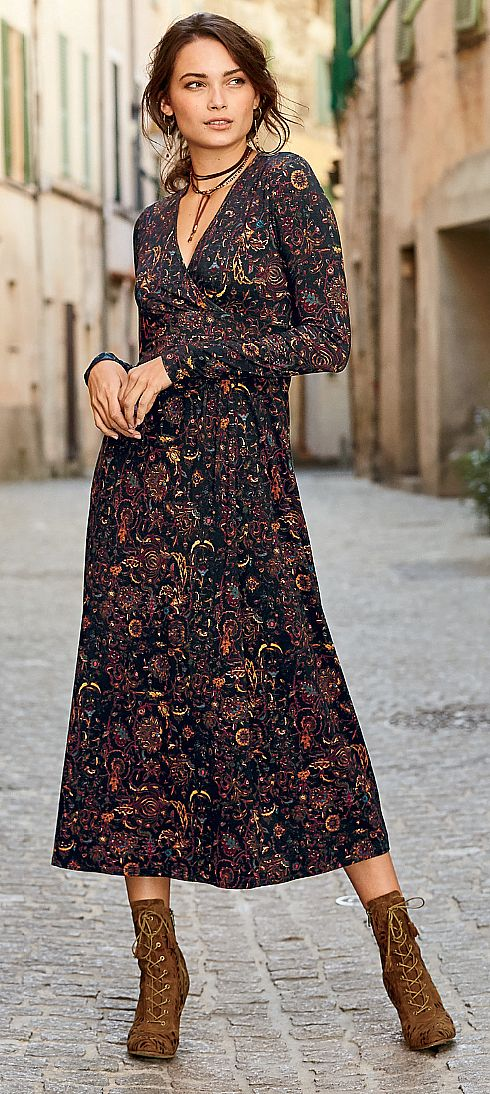 Darkly romantic florals twine across our flattering faux-wrap dress in autumnal shades of sepia, olive, burgundy, raspberry and cerulean. Sewn of fluid viscose (95%) and elastane (5%) jersey, with a crossover v-neck and overlapped skirt. Constructed with a lined bodice, waist-slimming gathers on one side and A-line skirt.