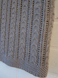 A cosy baby blanket with little cables and easy lace pattern.