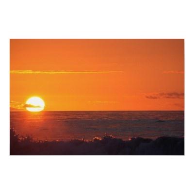 Sunset over the waves on Hokitika Beach, South Island, New Zealand