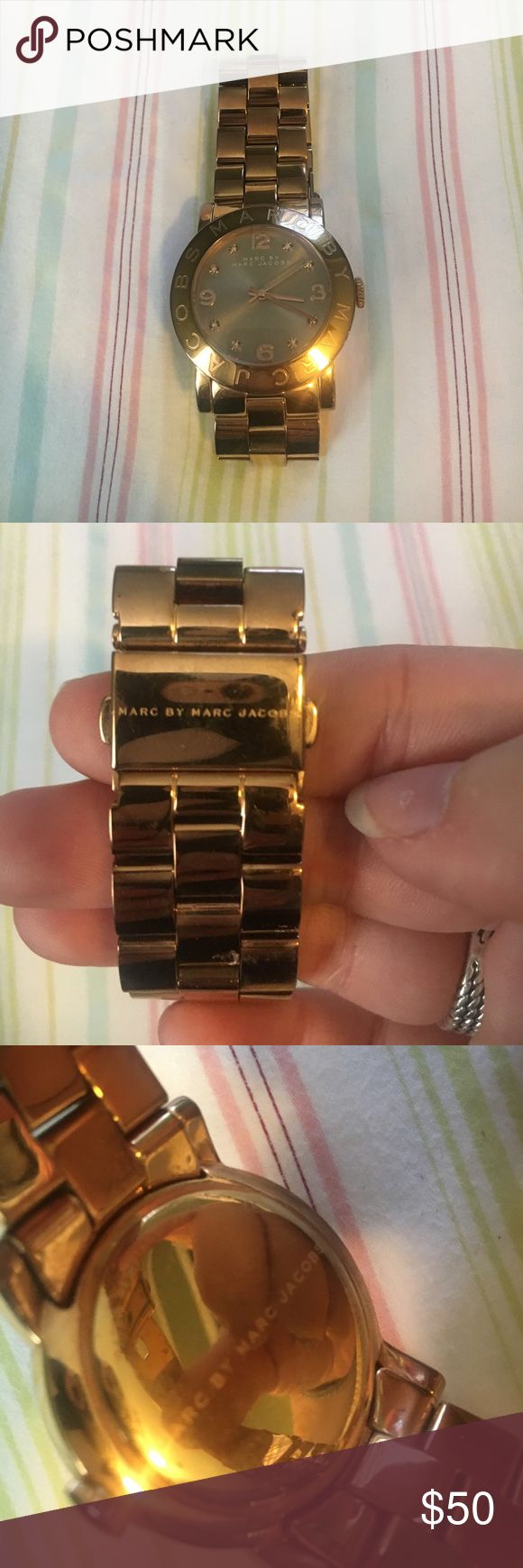 Marc Jacobs Watch Stainless Steele Marc Jacobs watch in rose gold. Amber colored crystals in watch face to represent some numbers. Some wear but nothing polishing won't fix. I have taken a few lengths out but have a somewhat large wrist so it should fit most. Marc by Marc Jacobs Jewelry Bracelets