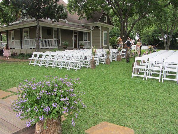 Tree trump used as flower vase at rustic, outdoor wedding