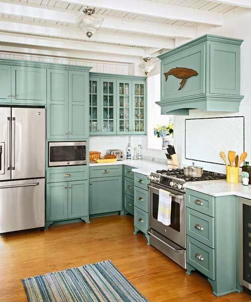 Homes and styles: Teal kitchen cabinets with glass fronts