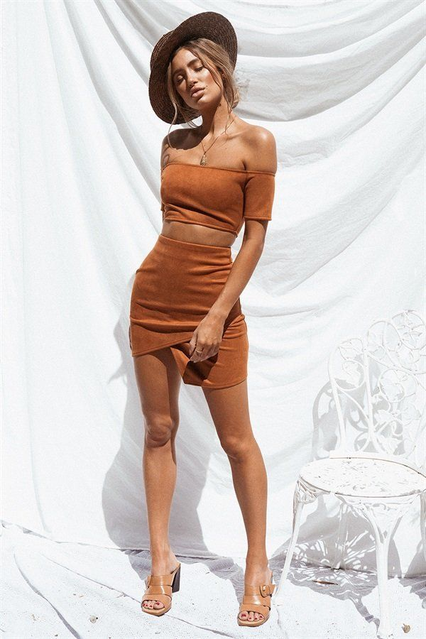 Show off your curves in the Lenny Skirt, made from a faux suede fabric in a burnt orange hue. It is a high waisted style and features asymmetric hemlines, a wrap style overlay and zip for the perfect fit! Get the look by pairing with the Lenny Top! By Sabo Skirt.