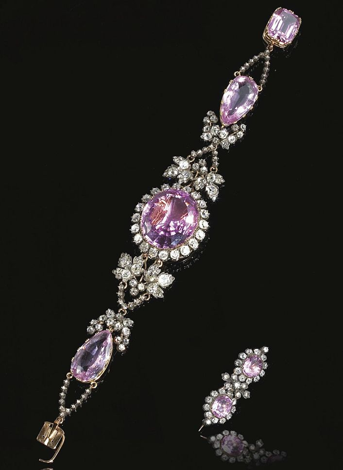 RARE PINK! TOPAZ AND DIAMOND BRACELET, CIRCA 1830. The central oval pink topaz set within a border of old-mine diamonds, on an articulated bracelet set with two pear-shaped pink topaz, interspersed with vine leaf motifs set with circular- and rose-cut diamonds, the detachable clasp set with a cushion-shaped pink topaz, accompanied by a brooch set with similar stones,  Central element can be worn as a brooch.