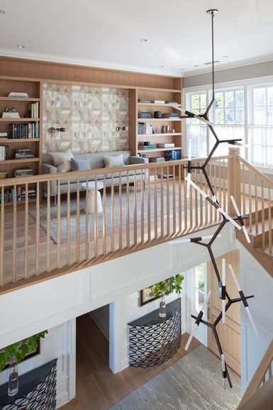 Principal architect Steve Hoedemaker and project architect Kelly Jimenez replaced a grand curving staircase with a more modern rectilinear design to enhance the connection between the entryway and other rooms in the house | archdigest.com