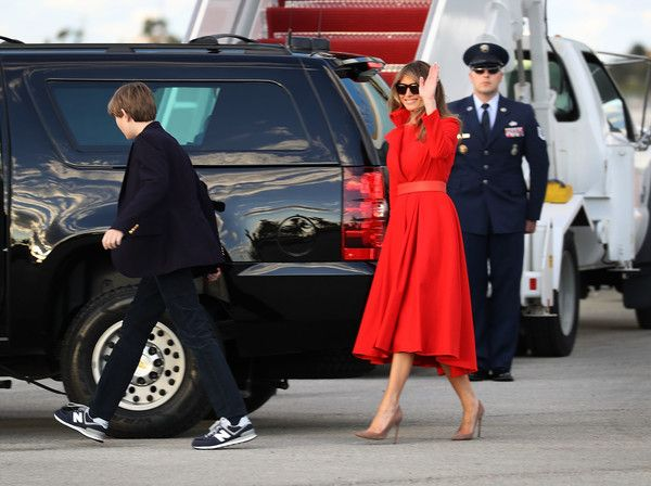 Melania Trump Photos Photos - President Donald Trump's wife Melania Trump and their son, Barron Trump walk to their vehicle after arriving together on Air Force One at the Palm Beach International Airport to spend part of the weekend at Mar-a-Lago resort on March 17, 2017 in West Palm Beach, Florida. President Trump has made numerous trips to his Florida home since the inauguration. - President Trump Arrives In Florida For Weekend At Mar-A-Lago Estate