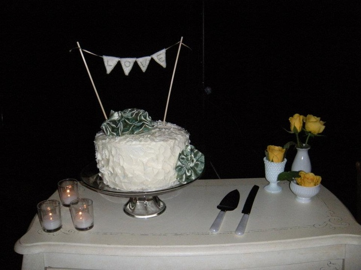 close up of the cake. I made the satin flowers from a vintage dress! It was already cut up so, why not?