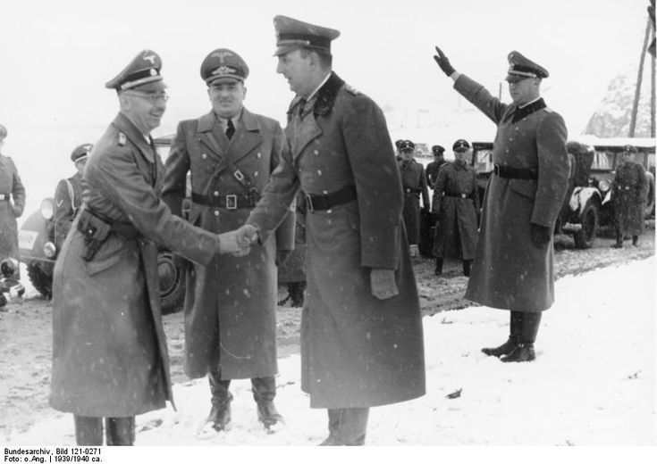 "Meeting of killers. Order Police SS Daluege (right) in 1939, shaking hands with Heinrich Himmler (left). Hans Frank, governor of the ""General Government"" area of occupied Poland, is also standing between the two men. Frank and Daluege were hanged. Himmler committed suicide."