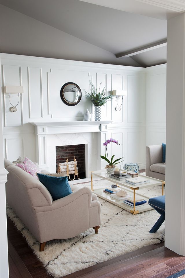 Metrie's very own French Curves Collection's crown moulding, baseboard and panel mould make an appearance in Nancy Marcus' living room transformation.