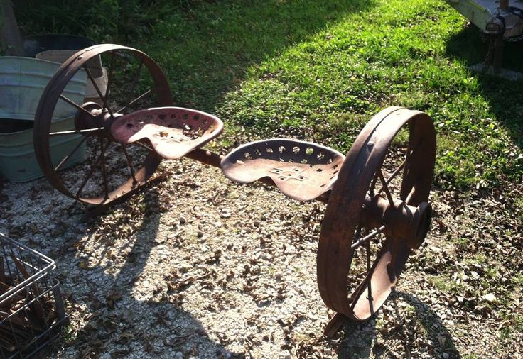 Here's a cool bench made from old tractor seats and wheels!