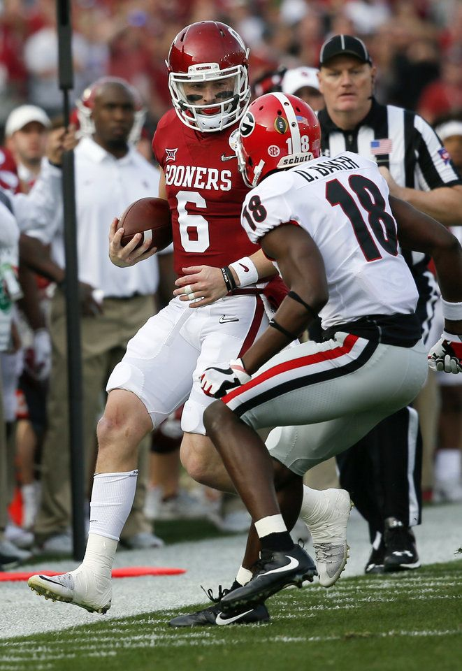 3c30baabc Oklahoma s Baker Mayfield (6) keeps the ball for a first down as Georgia s  Deandre Baker (18) defends in the second quarter during t…