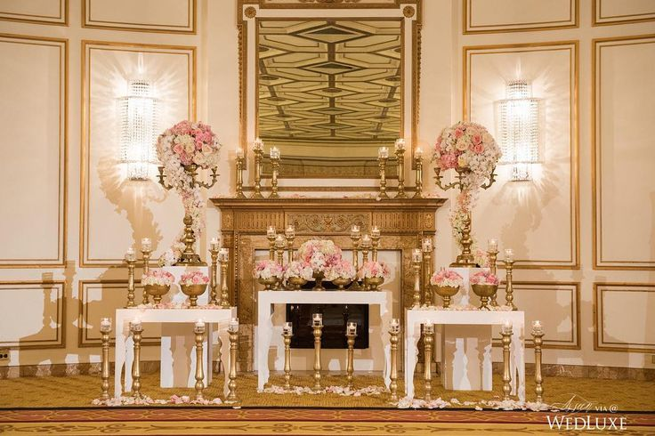 This dreamy #ceremony featured gilded candelabras wrapped in blush blooms and bowls overflowing with pink and white flowers. Scattered petals and glimmering candles completed this majestic design! | Photography By: Jasalyn Thorne Photography | WedLuxe Magazine | #luxury #wedding #luxurywedding #weddinginspiration #decor #decordesign #ceremonyvenue