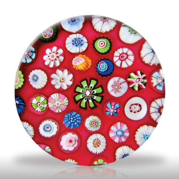 Clichy spaced millefiori. Not every antique paperweight excites me but this one is mighty nice! The rich ground and even spacing make it a stunner.