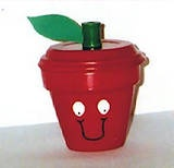 Cute apple candy holder made using a clay pot and saucer.