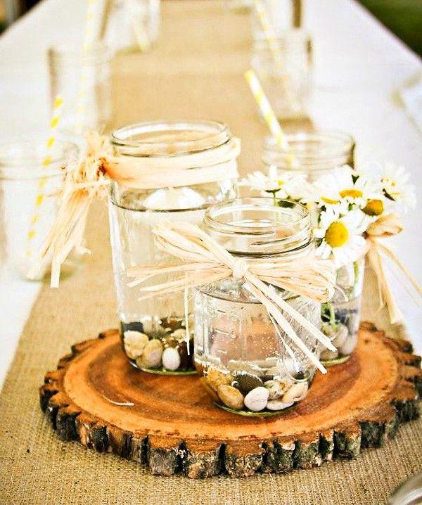 Centre de table mariage bocaux en verre.