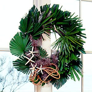 Palm Frond Wreath Deck the windows with a hassle-free palmetto wreath reminiscent of palm-lined beaches. Start with a 26-inch form covering with palmettos and Spanish moss, then trim it with rope and sea stars.
