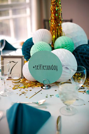 Personalized hashtag table numbers, gold glitter and colorful paper accordion balls for a modern bat mitzvah by Michelle Edgemont  Michelle Edgemont | Decorations. Florals. Styling. Awesome.