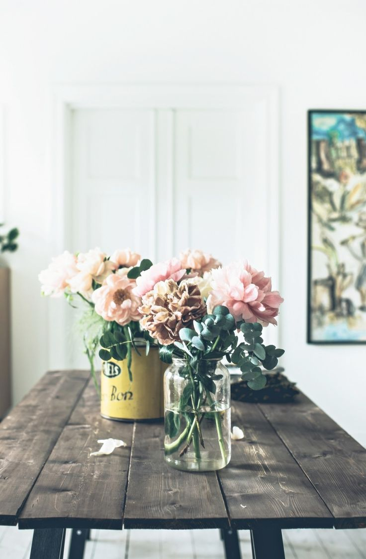 oooh. What do you think of white peonies and eucalyptus in a set of three different vessels on the kitchen table?