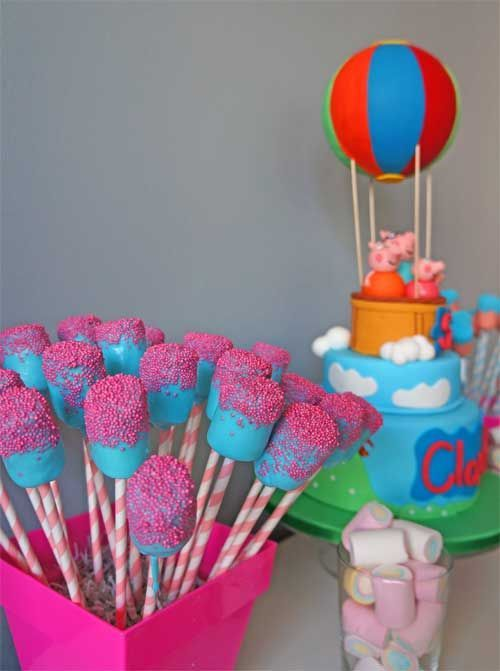 Peppa Pig Rainbow marshmallow pops dipped in blue icing or could do white chocolate