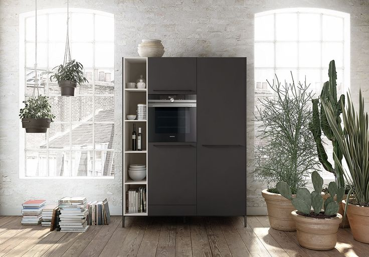 The minimalist kitchen cabinet from SieMatic's Urban line | Remodelista A companion cupboard from the Urban collection fitted with a wall oven, panel-concealed refrigerator, and open storage.