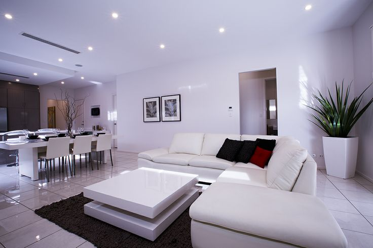This modern and fresh open living area gives the Mayfair a grand atmosphere. #living #lounge #weeksbuilding