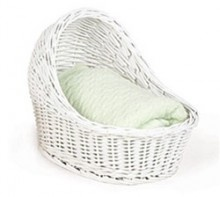 White Wicker baby carriage basket, empty, waiting for you to fill it up with the baby products you choose.