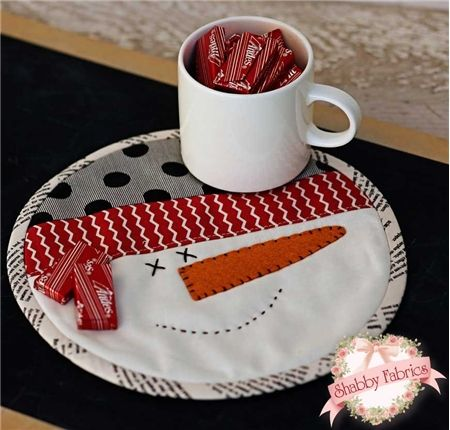 "Snowman Mug Mat: Let this snowman join you for your morning coffee! Mug Mat finishes to 8"" diameter. Make one for you and extras for all your friends! http://www.shabbyfabrics.com/Snowman-Mug-Mat-P19007.aspx?categoryid=947 Pattern: $3.00"