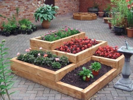 Tiered-gardens-and-pots.  I love this!