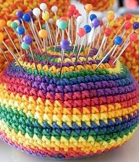 crocheted rainbow pincushion