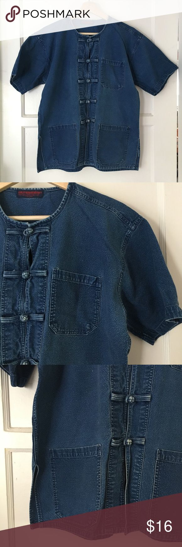 """Vintage Asian Denim Short Sleeved Shirt/Jacket This darling little lightweight boxy denim smock top could be worn as a shirt or short sleeved jacket. Three pockets! No stretch. Frog button closures are so cute! Well loved and nicely broken in—signs of wear in the dark denim, but no flaws on the outside. A small place inside where the seam is unraveling. See last photo. Can't translate label, but probably a large. See measurements below.   Width (pit-to-pit): 22"""" Length: 25"""" Approximate hand…"""