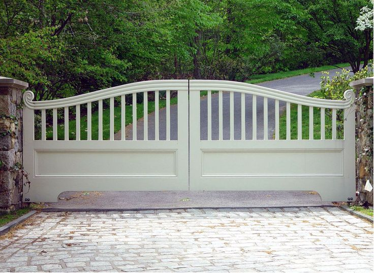 This wooden gate features an understated classic scroll design along the top of the gate. Designed and installed by Tri State Gate in Westchester County, New York.