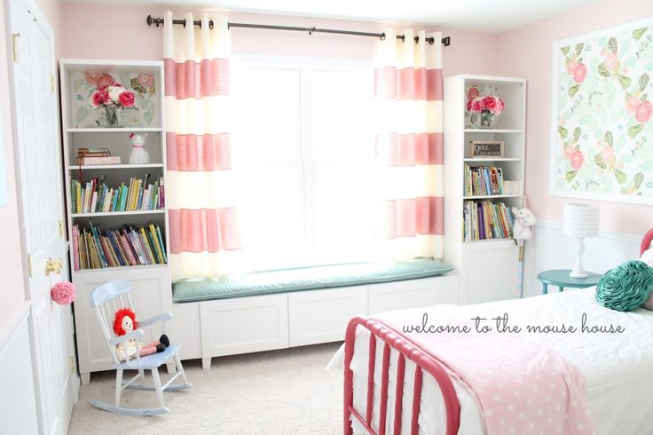 We wanted to create a window seat for our four year old girl, so we purchased 2 BESTA bookcases for either side of the window. In order to create the window seat, we added 2 lower cabinets, but they weren't quite long enough, so we had to create faux panels using the extra shelving. We [&hellip