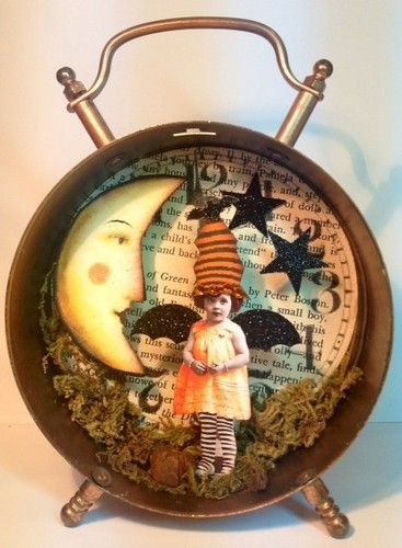 LOVE THIS! Altered art fairy with in a vintage clock. Halloween COOL!