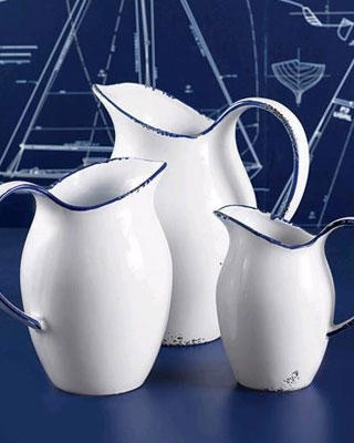 white enamel pitchers with royal trim. Love the nautical background.