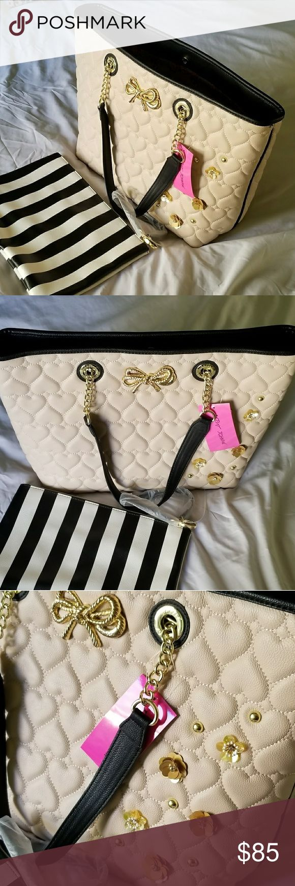 FREE SHIPPING Betsey Johnson Tote NWT Betsey Johnson Tote with make up bag. Cream in color, gold and black detail.  FREE SHIPPING ON ORDERS OVER $50 Betsey Johnson Bags Totes