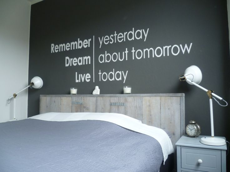 I love the driftwood colored headboard, dark wall color, and minimalistic typography. Sans-serif for the win.