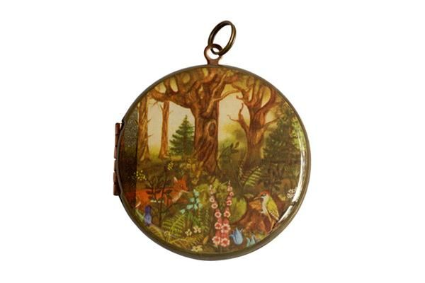 For Protection of the Environment, this Polish postage stamp features a forest life representation and was released in 1973. The vintage locket is made from brass and copper and measures 38mm in diameter. The locket opens from the side and is capable of holding 2 of your most precious memories inside.