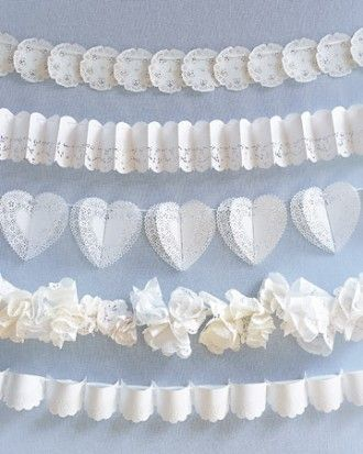 """Garlands"" Doilies and silk ribbons combine to make graceful garlands to be draped over pews at the wedding ceremony or festooned along reception tables."