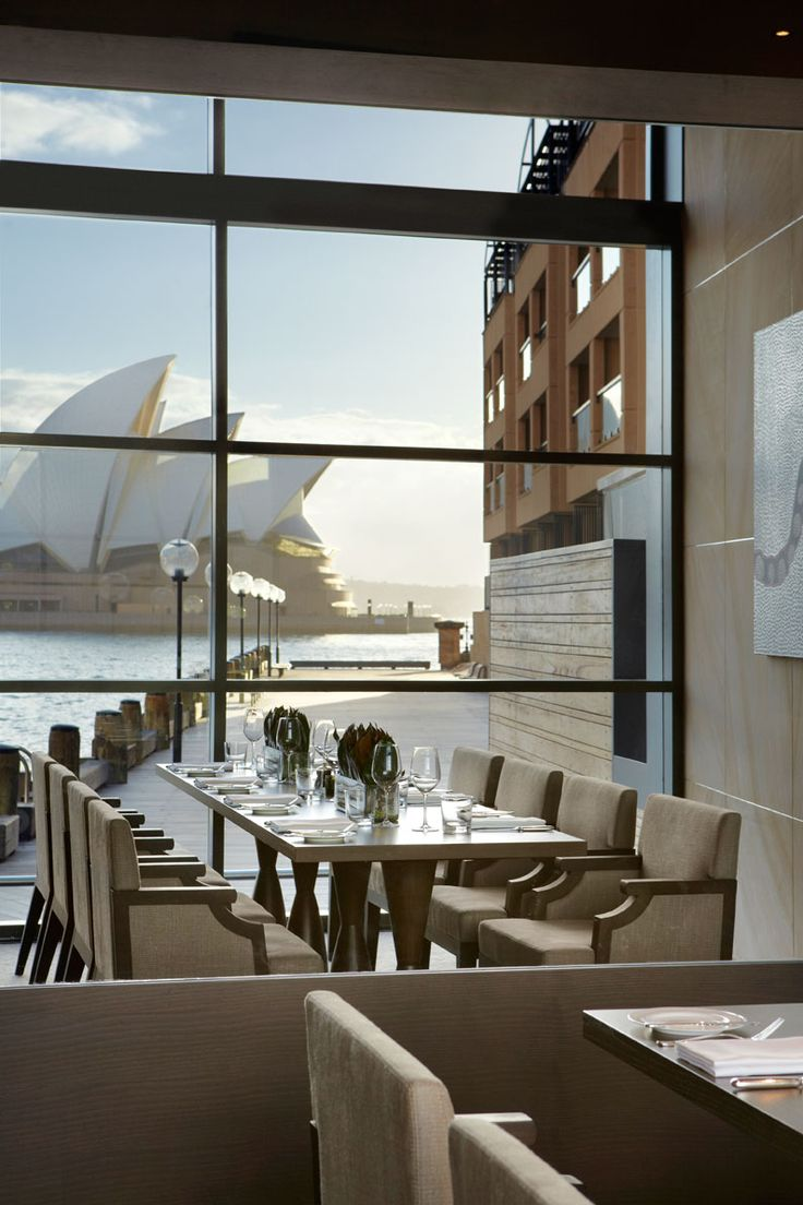 The Living Room at Park Hyatt Sydney is a luxurious and relaxed setting featuring timber flooring, sunlit-drenched lounges, floor to ceiling glass windows, and a panoramic view of Sydney Harbour. The Living Room serves up a decadent Champagne high tea.
