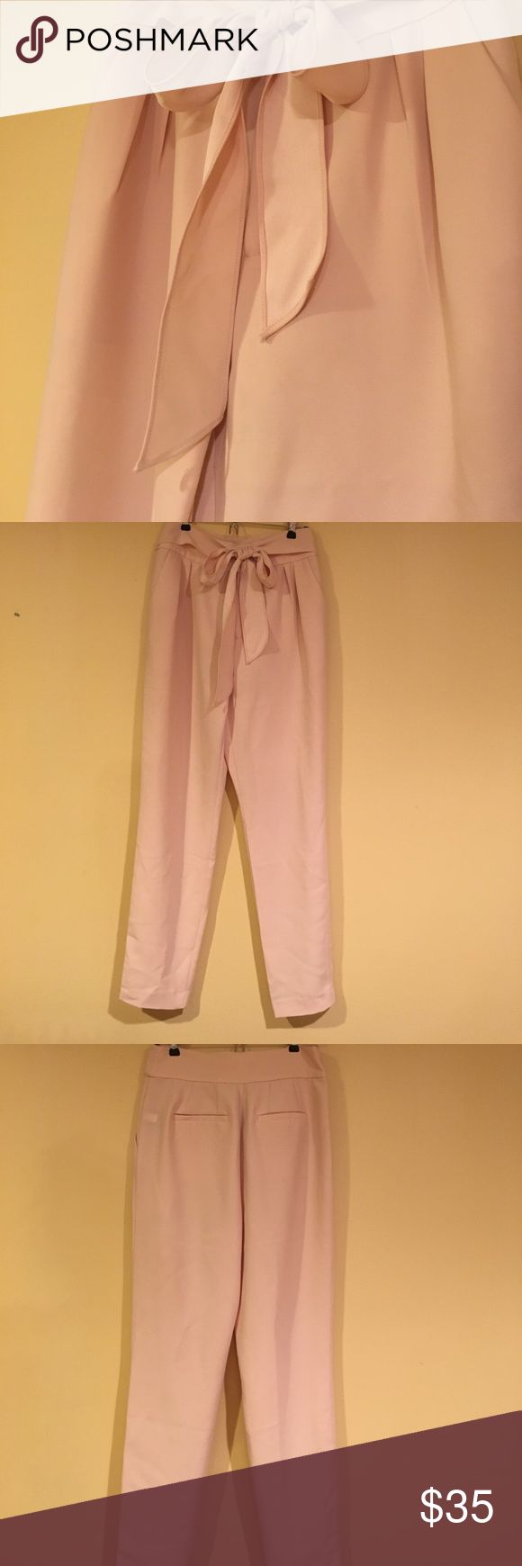 New with tags Light Pink pants Brand new from the current collection of Bebe. Fully lined, nice fabric trousers With two sided satin thigh side pockets, nice fit. I bought it and put it in my closet, realize it didn't fit me, too late to return it. Tags are still on it never worn, paid $98. Price just reduced no further discounts bebe Pants Trousers