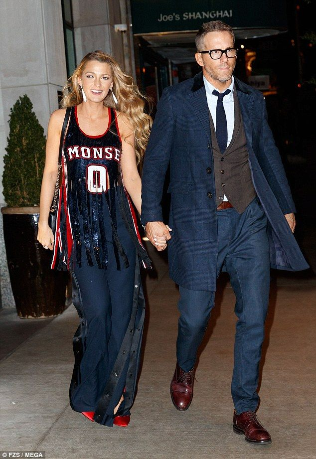 Right hand man! Hubby Ryan Reynolds was by her side as they headed out from the long day of event