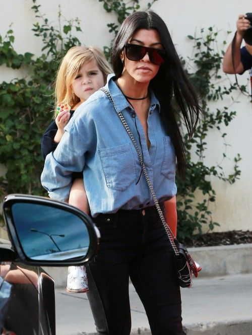 We love how Kourtney K. makes this chambray top look edgy! Click here to get yours!