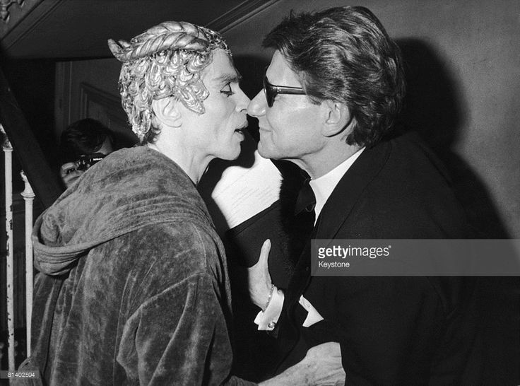 French fashion designer Yves Saint Laurent (1936 - 2008) with Russian ballet dancer Rudolf Nureyev (1938 - 1993) after the launch of Saint Laurent's new aftershave, 'Kouros', Paris, 23rd February 1981. The launch featured a performance by Nureyev in a gala night of entertainment at the Opera comique.